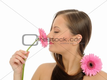 Beautiful woman with pure skin,long hair with 2 pink flowers