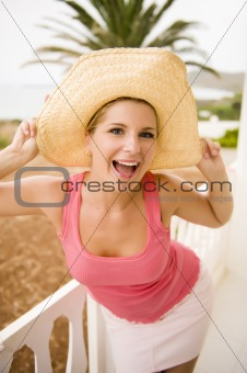 Portrait of young sexy crazy summer woman in large hat relaxing