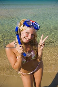 Young happy beautiful summer woman with swimming mask and snorke