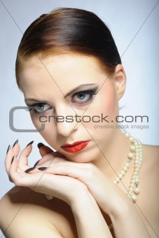 Young elegant beauty female face with red shiny lips