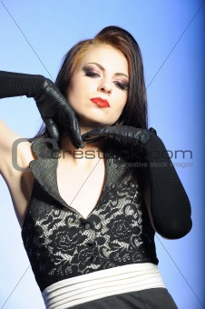 Portrait of sexy fashion woman with red lips in black dress