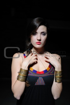 Beautiful model girl with long hair and bright make-up touching