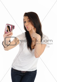 beautiful woman taking her own pictures on a digital camera