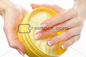 Beautiful hands with perfect nail french manicure, cream