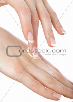 Beautiful hands with perfect nail french manicure and cream