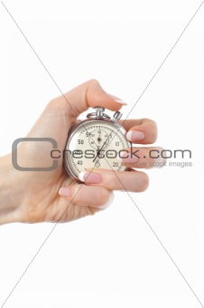 Beautiful womans hand with stop watch. isolated