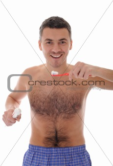 Middle aged man brushing his teeth in the morning. isolated