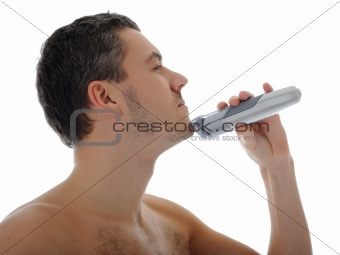 Young handsome man shaving in the morning . isolated on white