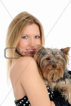Beautiful blong girl holding small cute york terrier dog.
