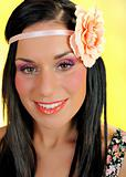 Young beautiful woman face with creayive eye make-up and flower