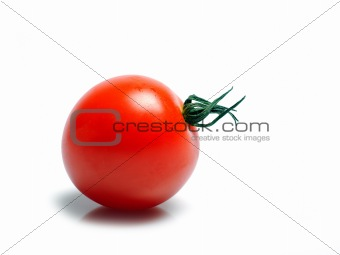 Beautiful red cherry tomato isolated on white background