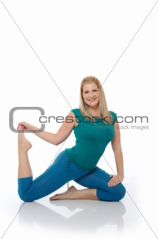 Beautiful happy woman doing pilates pose. isolated on white