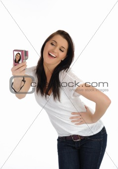 beautiful casual woman taking photos on a digital camera