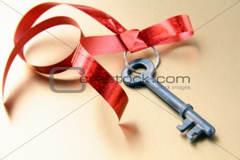 old key with a red ribbon