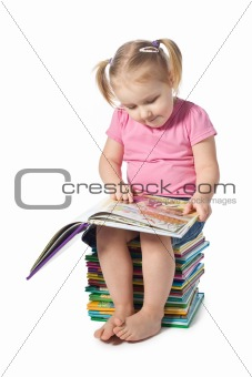 small child reading a book
