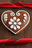 Gingerbread heart and red ribbon