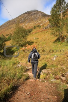 Man hiking through the Scottish hills