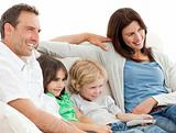 Parents and children watching television together