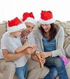 Happy parents with thir opening crackers together