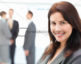 Charismatic businesswoman posing in front of her team