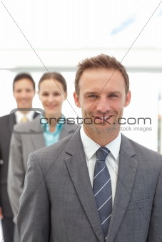 Three happy business people posing in a row