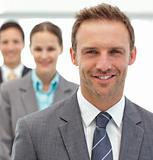 Businessmen and businesswman posing together in a row