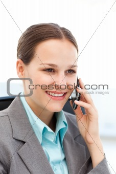 Female executive using her cellphone at her desk