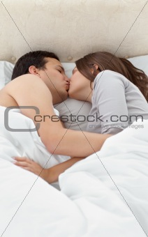 Adorable couple kissing while