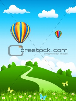 hot air balloon over green landscape