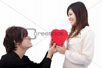 Asian young Man handing over love gift  to  young woman