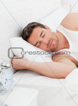 A peaceful man in his bed before waking up