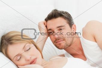 Boyfriend looking at his girlfriend who is  sleeping