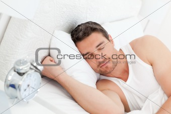 A calm man in his bed before waking up