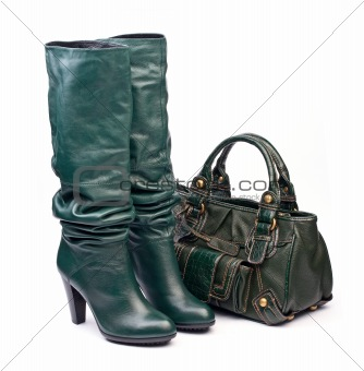 Green female high-heeled boots and leather bag