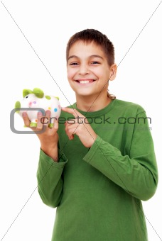 Teenage boy showing piggy money box