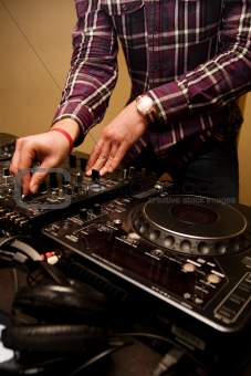 Hands of a Dj playing music