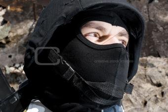 Portrait of armed soldier in helmet