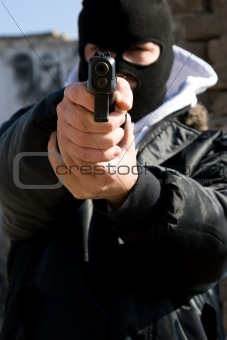 Armed criminal aiming you