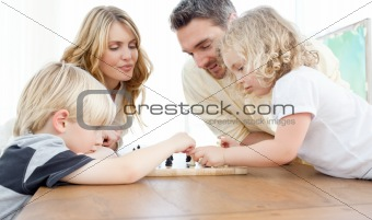 Family playing chess on a table