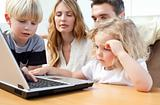 Family looking at their laptop