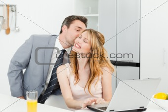 Businessman kissing his girlfriend