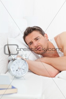 A angry man in his bed before waking up