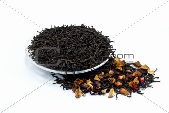 black tea leaves with dried fruit tea on white background