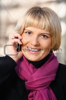 Beautiful young woman with her cell phone