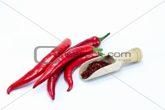 Fresh and crushed red pepper on white background