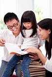 Happy asian family studing together.