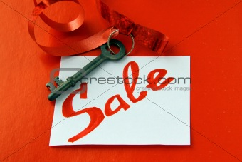 old key with a ribbon and with card