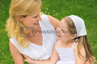 Portrait of young woman and her daughter - happy time