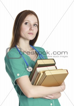 Portrait of kind female nurse in the green uniform with books