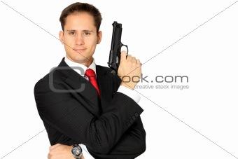 A secret agent posing with his gun